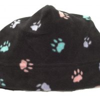 black fleece toque style hat with multi colored paw print pattern